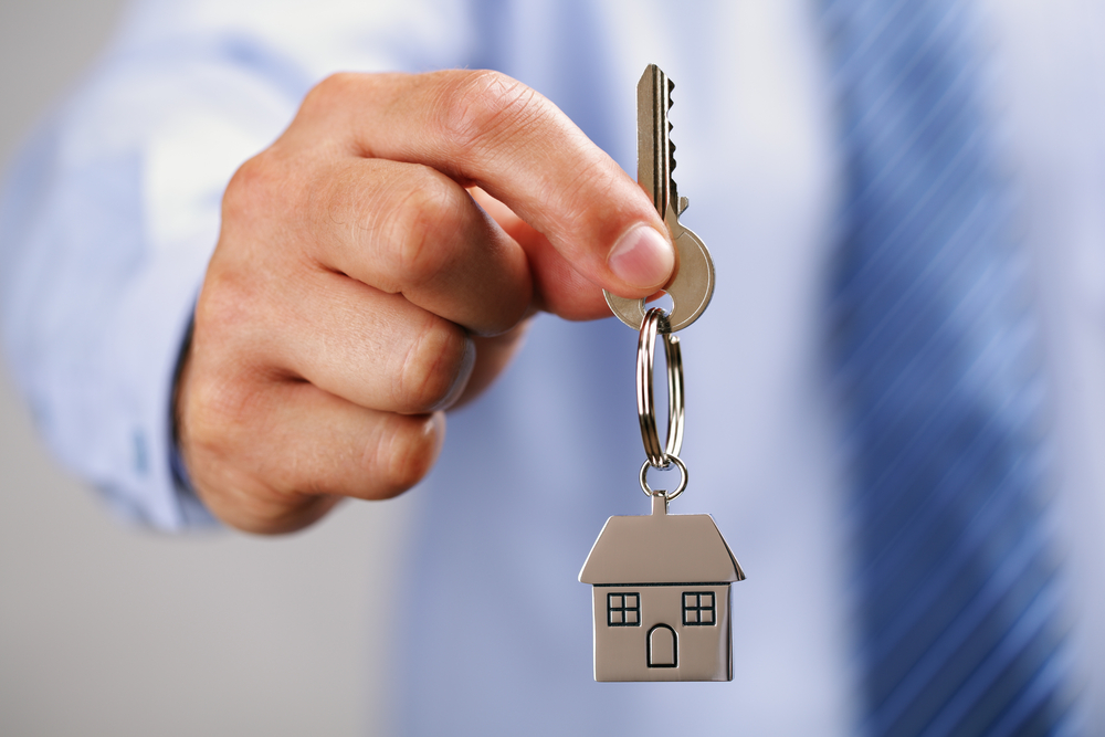 Image of a man holding a key - Real Estate Management